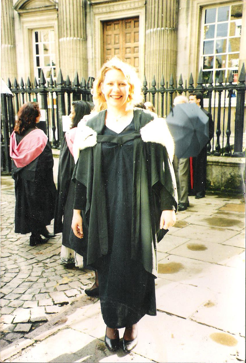 Sue getting her first degree outside Cambridge senate house